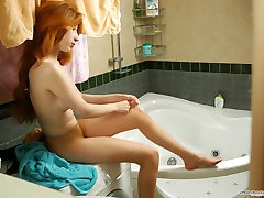 Beautiful chick putting on her new pantyhose just after taking hot shower