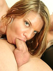 A studious looking MILF boss proves to suck cock like a pro