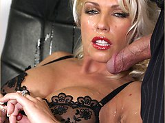 Office boss Leggy Lana takes a hot sticky facial from a business man while she's fully clothed in the office