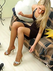 Voluptuous chick choosing comfy shoes to stroke her pink clad in pantyhose