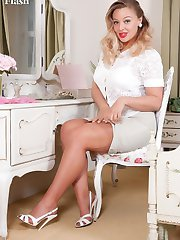 Lovely Beth is in the bedroom at her dressing table, looking especially gorgeous!