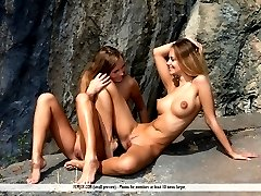 Two perfect babes strip down, stretch out, and get to kissing on a remote, private beach. What could be better?