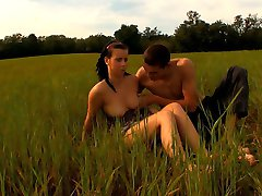 As the sun sets on this field, this young stud`s cock starts to rise. Soon, he`s sliding it deep inside of this teen`s tender pussy. He can`t believe how tight her pussy feels around his cock.