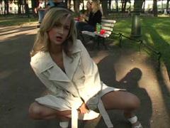 Nice teen exhibitionist posing on flick in public