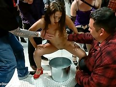 When Vicki Chase runs off to the bathroom to pee before her shoot Mr. Pete takes the opportunity to follow her and get a little off screen action before the night begins. But when Princess Donna comes in and finds them fucking in the bathroom stall she brings the party to them and makes Vicki piss in a bucket in front of a crowd of people. She is then held with her face in the urinal, made to squirt and cum uncontrollably, and reminded that this is all possible because of Princess Donna's love.