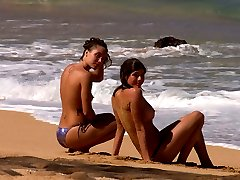 Naked babes enjoy ocean water