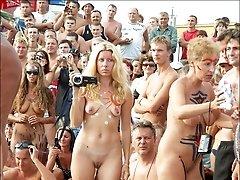 Regular bodyart carnival on a sandy public beach.