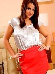 Brunette secretary stripping from her satin workwear