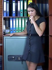 Oriental secretary masturbates at work mounting a desk in her tan stockings