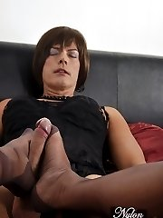 Horny Milf Nylon Jane wraps her nylon feet around this lucky Tgirls big cock, for an awesome nylon encased footjob