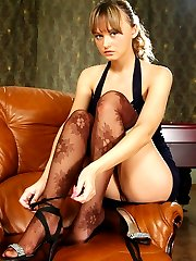 Nylon-crazy babe caressing herself and plays with new brown fashion tights