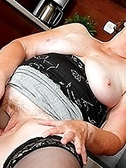 Naughty mature lady playing in the kitchen