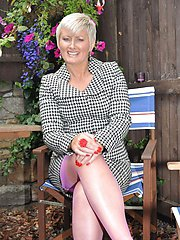 MILF gives her neighbours a look at her hot body