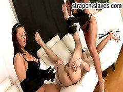 Crazy bitches drills all the holes of their slave by orange strapon