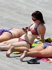 Girl sliding hand into bikini panty