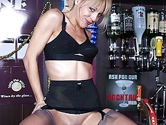 Zoe gets down to her girdle and nylons in the bar!
