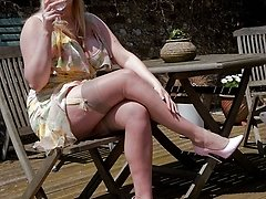 Huge-titted Michelle enjoying some sun in summer sundress and ff nylons!