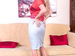 The leggy blonde MILF is sporting sheer red blouse and sexy matching panties under a tight pencil skirt!