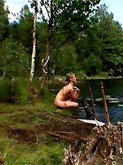 Cute teen girl is spied skinny dipping