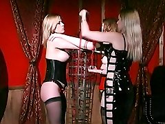 Dominatrix Mistress Erzsebet manhandles her slaves breasts and restrains them in this BDSM porn scene