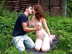 They`re out in the wide open, but that doesn`t stop this redhead nymph from taking off her clothes and letting her body be violated by this lucky stud.