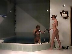 Covert cam films the lesbian gals in the pool