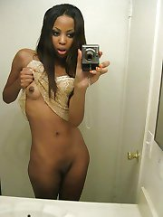 Naked black chick with pierced nips spreads