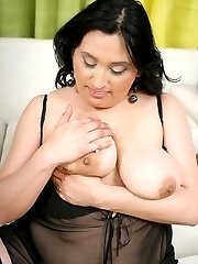 Hot BBW Claudia rubs cum all over big tits after a hot pussy plugging in the living room