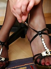 Woman co-worker pleasing her pussy and flashing her nyloned feet at work