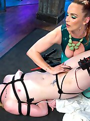 Bound and gagged, Katie Kiss is initiated into Electrosluts by hot dominatrix Bella Rossi with a wired pussy plug, the zapper, two electrified dildos, the violet wand, the sybian, face sitting, finger banging, a cattle prod to the pussy, and multiple orgasms!