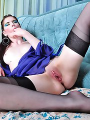 Heated chick in black nylons with a blue garter working her itching pussy