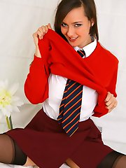 Naughty Nadia gives us a glimpse of whats beneath her college uniform.