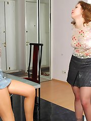 Filthy gal going wild teasing with her nyloned legs in stiletto heel shoes