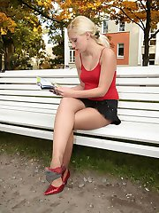 Blonde flasher wearing shiny tan hose with no underwear for outdoor play