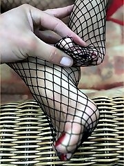 Leggy Lana puts on her brand new silky nylon fishnets, so this lucky fan can spunk all over them