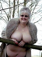 Fat granny posing nude in a park