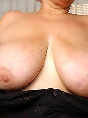 Baraca undressing off to flash and play with her massive boobs