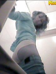 Pissing hottie squatted right over voyeur camera
