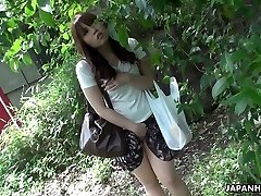 Beautiful and curious red-haired Asian teenager watches sex on the street and masturbates