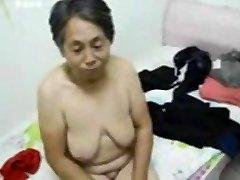 Asian Grandma get clad after sex