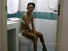 Thai Hooker Deep Throats Fuckpole in the Toilet