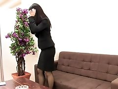 Girl in suit and pantyhose milks when she is alone