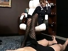 Spruce Japanese girl in stockings works her feet on a perverted
