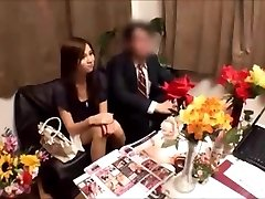 Japanese wife gets massged whilst husband waits