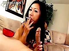 Tia Ling likes to suck on a cigarette and a hard weenie at one time