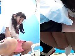 Oriental teens pee in toilet