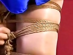 Pregnant Chinese lady is tied up with her abdomen hanging out an