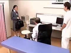 Medical scene of young na.ve Asian sweetie getting checked by two mischievous docs