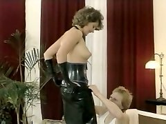 Hussy mistress in latex outfit gives deep-throat blowjob
