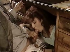 Slutty secretary gives her chief a blow-job under the table